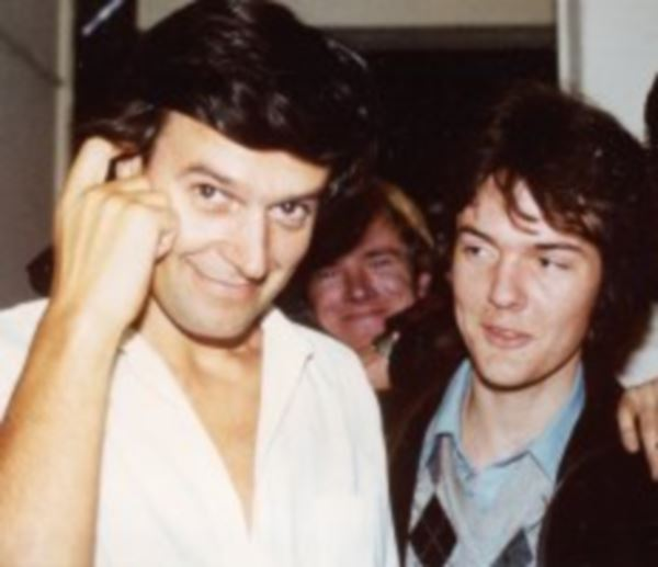 The author and his musical mentor, Greg Gillet (background) meeting John McLaughlin.