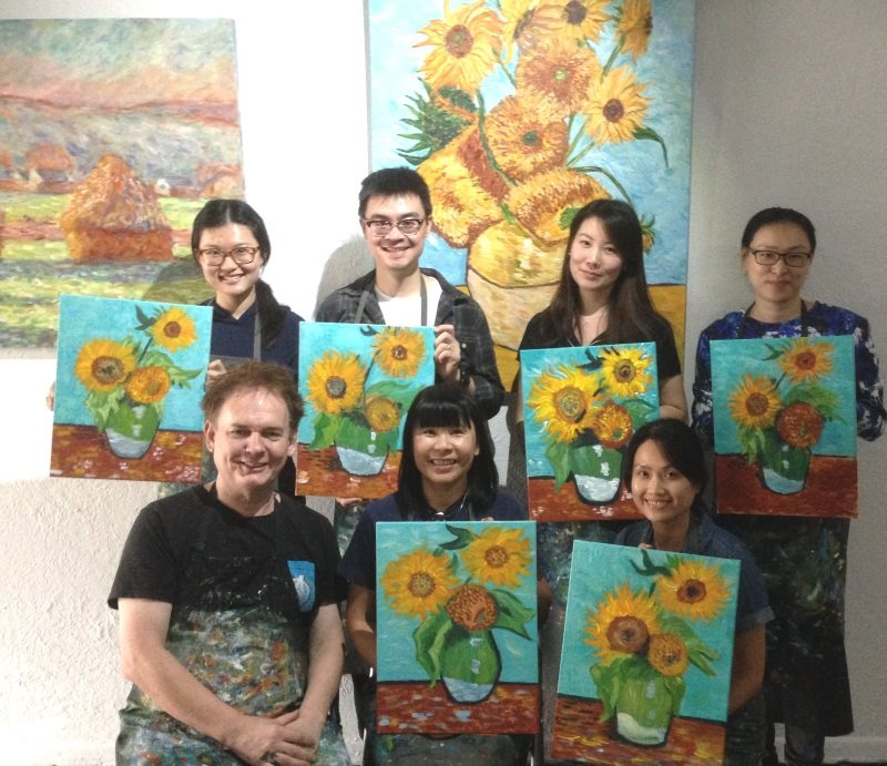 Grace and other students with their first version of Van Gogh's Sunflowers No.1, completed in one session at Inglis Academy.